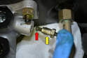 This photo illustrates the flared end of the brake line (red arrow) that seals against the master cylinder.