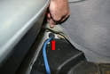 Follow the sensor wiring and remove the grommet from the chassis (red arrow) so you can pass the wiring through.