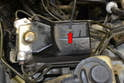 To check or replace the relays use a T15 Torx driver and remove the single screw (red arrow) holding the cover plate on.