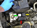 Remove the cover and you have easy access to the wiring harness connection (red arrow), the 12 volt relay (yellow arrow) and the ABS pressure regulator (green arrow).