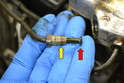 This photo illustrates the end of the brake line and nut.