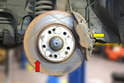 This photo illustrates the front brakes on the W124.