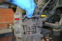Remove the two brake wear sensors by gently pulling the sensor end from the pad (red arrow) and then removing the end from the connector on the caliper (yellow arrow).