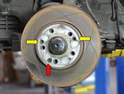 The rotor is held to the hub by two roll pins (yellow arrows) and a 4mm Allen screw (red arrow).