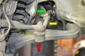This photo illustrates how the tie rod (yellow arrow) connects the steering rack (via Pitman arm and drag link) to the steering knuckle by a ball joint on the knuckle (red arrow) and drag link (green arrow) end.