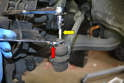 To remove the ball joint use a 5mm Allen (yellow arrow) to keep the joint from turning while using a 17mm wrench to remove the nut on the joint (red arrow).