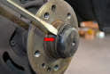 Remove the dust cap from the front of the wheel hub.