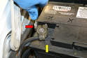 Begin by disconnecting the ground strap (red arrow) from the battery's negative terminal (yellow arrow) with a 13mm wrench.