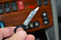 The W124 radio uses the key with an approximate 30 degree angle cut in it.