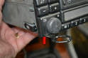 There is a slot on each side of the unit to slide the key into (red arrow).