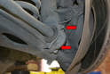 Undo the two nuts holding the sway/torsion bar to the front of the wishbone and remove the bracket.