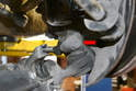 Remove the'mm nut and bolt on the clamping sleeve to the ball joint (red arrow).