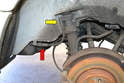 The shocks (yellow arrow) connect to the lines from the leveling valve (red arrow) via a rubber hose.