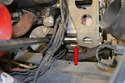 You need to use a 17mm socket and loosen the nut on the back of the alternator (red arrow).