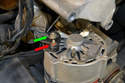 If you are replacing the alternator remove the two electrical connectors using an 8mm and 13mm wrench.