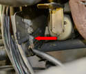 Here you can see the corrosion (red arrow) in both the strap and mount.