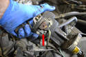 With the distributor out of the engine you can use a 6mm wrench and remove and replace the condenser wire (red arrow) that sends a signal to the ignition control unit.