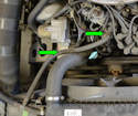 Remove small hose going from the top of the thermostat housing to the coolant reservoir (green arrows).