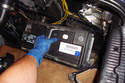 Grab the battery by its handles and lift if out of the trunk cavity.