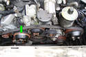 You will probably have to hold the cooling fan pulley (green arrow) still while you remove the 8mm Allen head fastener recessed in the fan clutch.