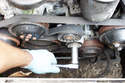 Tighten the 19mm drive belt tensioner fastener to hold the adjustment in place.