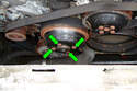 Loosen the four 10mm fasteners that hold on the idler pulley (green arrows) while the belt is still on the pulley.