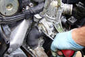 Loosen the upper hose clamp at attaches to the thermostat housing.