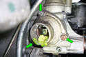 Remove the three 10mm fasteners (green arrows) that hold the thermostat housing to the water pump.