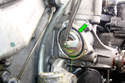 Pull the thermostat element out of the water pump if corrosion is holding it in.