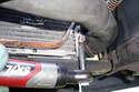 This photo illustrates underneath the car on the right side looking at the lower radiator hose.