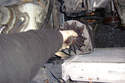 Pull the alternator up between the engine and the radiator being very careful not to bang up against the radiator.