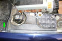 Lift up on the right side engine compartment cover to expose wiring and fasters.