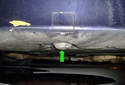 Under the car you will see a chassis pad (green arrow).