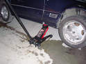 Place the jack under the jack pad of the corner of the vehicle you want to work on and jack up the vehicle.