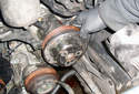 Remove the pulley from the power steering pump.