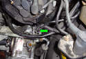 Remove the tie down (green arrow) that holds some electrical wires to a bracket on the power steering pump housing.