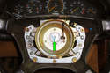 Remove the 10mm Allen head fastener (green arrow) that holds the steering wheel onto the steering column.