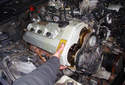 Lift up on the valve cover to remove it from the cylinder head.