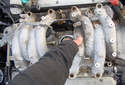 You should now be able to lift up on the intake manifold and separate it from the engine.