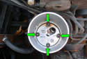 Remove the four T10 Torx fasteners (green arrows).