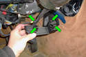 There are four clasps (green arrows) that hold the back cover onto the steering column.