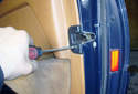 This picture illustrates the rear of the door, working at the door latch.