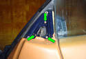 Remove the three Phillips head fasteners (green arrows) that hold the mirror onto the door.