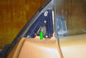 Remove the single Phillips head fastener (green arrow) that holds the electrical connector to the side view mirror assembly.