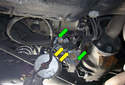 While the assembly is hanging down remove the two 6mm fasteners (green arrows) and two 8mm fasteners (yellow arrows) that hold the power and ground supply to each of the two fuel pump motors.