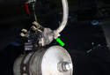 Loosen the hose clamp and remove the fuel return line hose from the pressure regulator that is part of the fuel pump assembly.