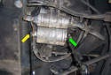 While you still have the 19mm wrench on the back end of the fuel filter (green arrow), loosen the 17mm banjo bolt (yellow arrow) at the front of the fuel filter.