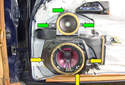 Remove the three Phillips head fasteners (green arrows) and three 8mm fasteners (yellow arrows) that hold on the speaker enclosures.