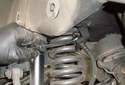 Rear Brake Hose ThisPicture illustrates behind the left side rear spring perch.