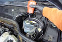 Use a suction tool to empty out the brake fluid reservoir as much as you can.